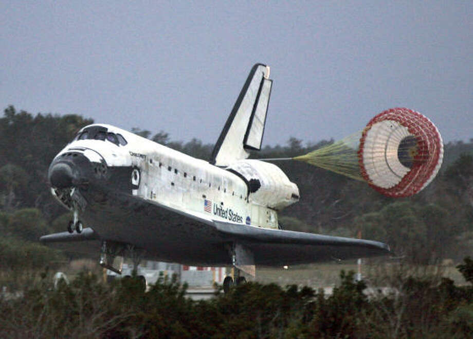 Discovery touches down at Kennedy Space Center in Florida on Friday. Because of the weather, NASA had considered landing Discovery in New Mexico. Photo: ROBERT SULLIVAN, AFP/Getty Images