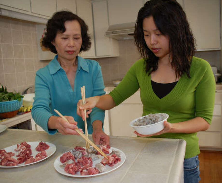 Bich Tran teaches her daughter, Mary Vuong, how to make Banh Xeo, a stuffed Vietnamese crêpe. Click through our photo gallery for a step-by-step guide. Photo: Christian Vuong, For The Chronicle