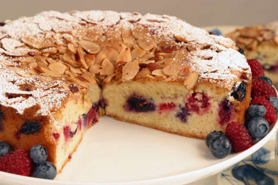 In addition  to a bounty of berries, Mixed Berry Almond Cake has almond slices on top and almond paste inside. Photo: Associated Press