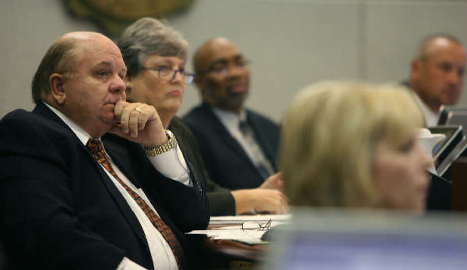 Cy-Fair ISD trustee Bob R. Covey, left, listens to speakers at Tuesday night's Cy-Fair ISD school board meeting. Photo: Sharon Steinmann, Houston Chronicle