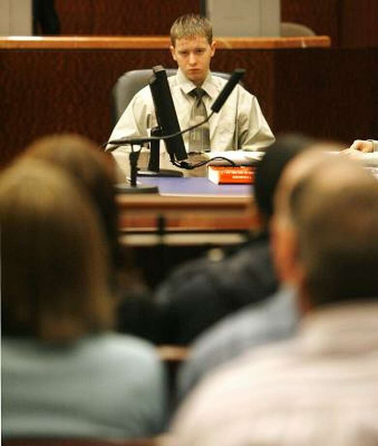 Keith Turner, 17, accused of aggravated sexual assault in a pipe attack on another teen, watches jury selection on Monday. Photo: Billy Smith II, CHRONICLE