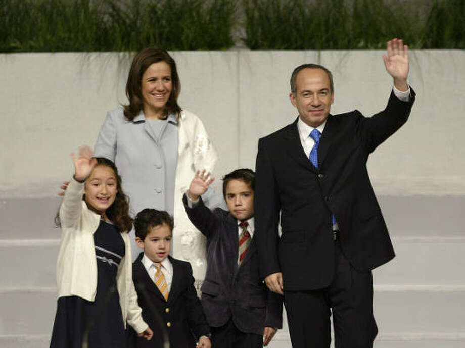 At left, Margarita Zavala, with President Felipe Calderon and their children, is expected to draw far less fire than her predecessor, Marta Sahagun, shown at right with former President Vicente Fox. Photo: GUILLERMO ARIAS, AP