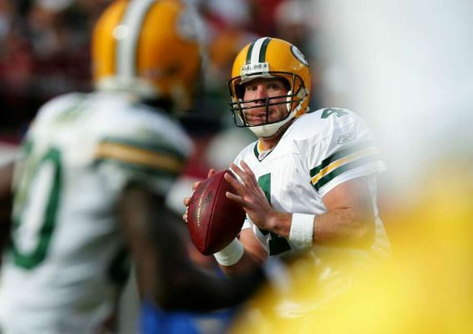 Green Bay quarterback Brett Favre made a triumphant return to Candlestick Park on Sunday, passing for 293 yards and two touchdowns in the Packers' victory over the San Francisco 49ers. Favre has won 11 of his 12 meetings with the 49ers over 15 years, throwing a TD pass in each game. Photo: Jed Jacobsohn, Getty Images