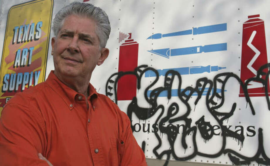 John Gilbreath, general manager of Texas Art Supply on Montrose, stands next to a truck that was recently a target of a tagger. Gilbreath says he supports efforts to curb graffiti, although his store will be affected by the new limits on the sale of markers and paints. Photo: Gary Fountain, For The Chronicle