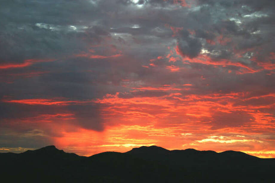 The sun rises over the Davis Mountains at Cibolo Creek Ranch in a spectacular display of color. Photo: TRACY BARNETT, San Antonio Express-News