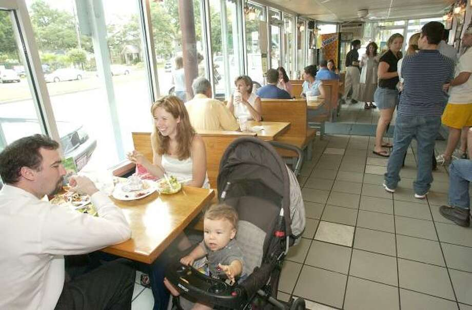 Customers enjoy lunch at Niko Niko's. Photo: Chronicle File