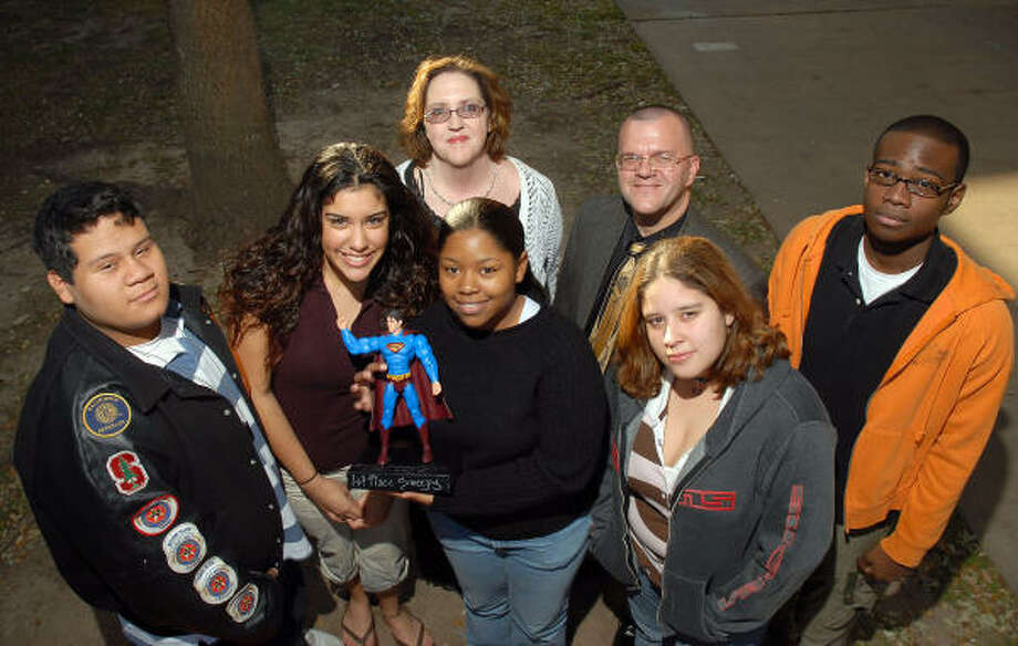 Scarborough High School students show off their trophy for winning the Riverdale High School National Invitational Tournament Nov. 10-11 in New Orleans. Shown are, front from left, senior Joe Walker, senior Natalie Gonzales, junior Brittani Batts, senior Alicia Jaramillo, sophomore Derrick Hill; and, back, Exxon Mobil volunteer Laura Fuller and Houston ISD director of UIL activities and team coach Michael Fain. Not pictured is Scarborough sophomore Gordon Taylor. Photo: Dave Rossman, For The Chronicle