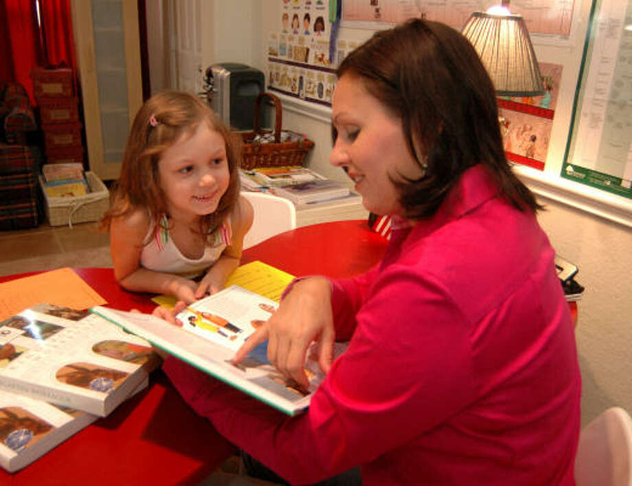 Rene Schiltz provides education for her daughter, Makenna, 6 at home. Photo: BRAD PERKINS, FOR THE CHRONICLE