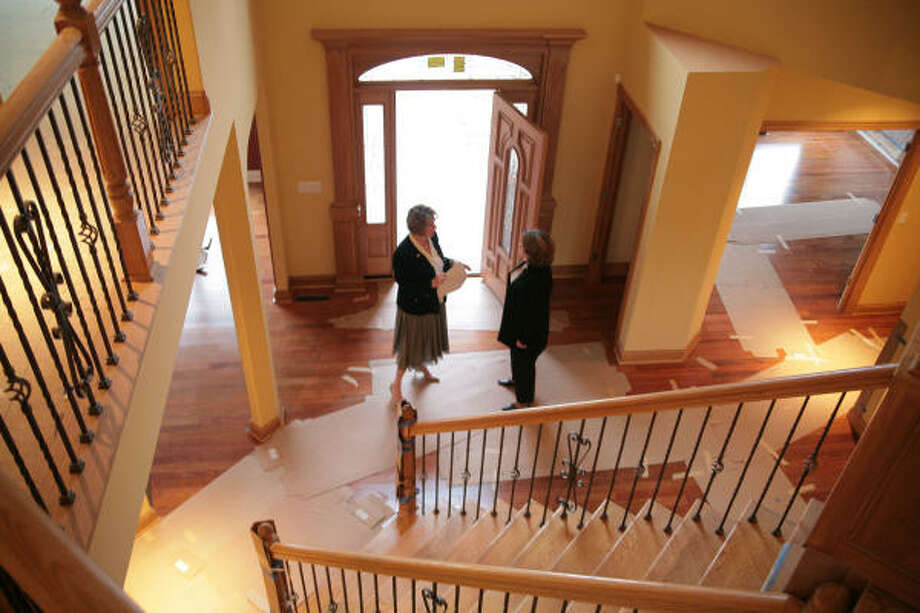 Real estate agent Susan Turner, left, and Maureen Downey discuss details of a new home near completion in Brecksville, Ohio. New-home sales rebounded in November, a sign that the housing slump may be nearing an end. Photo: JOHN QUINN, BLOOMBERG NEWS
