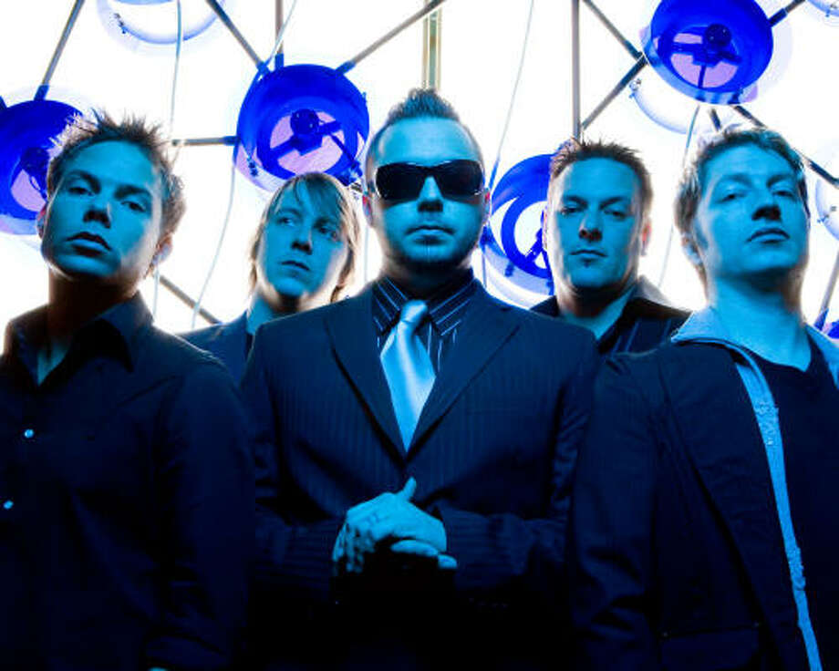 When Blue October's Justin Furstenfeld, center, performs here Saturday, it will be from a wheelchair, thanks to a knee injury.