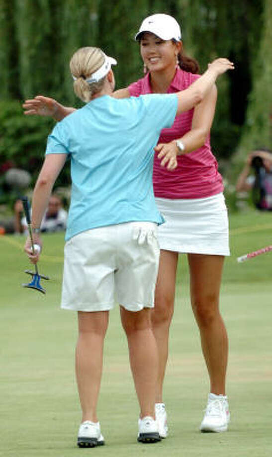 Karrie Webb of Australia, left, is congratulated by Michelle Wie after winning the Evian Masters women's golf tournament in Evian, eastern France. Photo: PATRICK GARDIN, AP