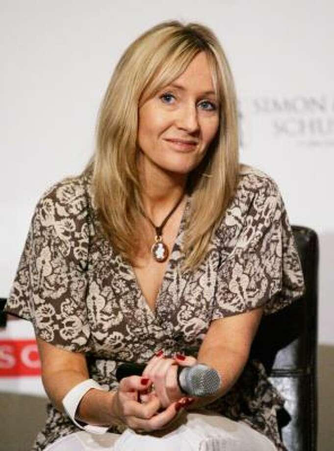 "Author J.K. Rowling participates in a news conference for ""An Evening With Harry, Carrie and Garp,"" a reading with Rowling, Stephen King, and John Irving, at Radio City Music Hall. Photo: Evan Agostini, Getty Images"