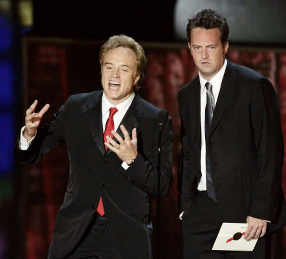 Bradley Whitford, left, and Matthew Perry make the award presentation for outstanding lead actor in a comedy series. Photo: CHRIS CARLSON, Associated Press