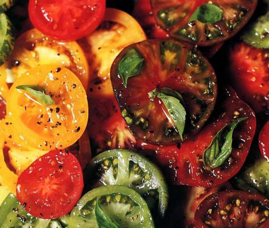 Three to 4 pounds of small heirloom tomatores are the main attraction in Fanny's Tomato Salad with Crispy Shallots. Photo: CHRISTOPHER HIRSHEIMER, Chronicle Books / Associated Press