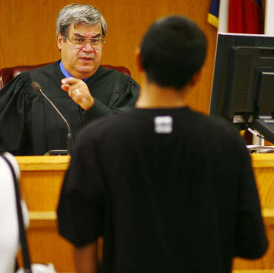 Judge David Fraga presides in a Houston juvenile court, where he sees almost all who received curfew citations. Photo: Steve Ueckert, Chronicle