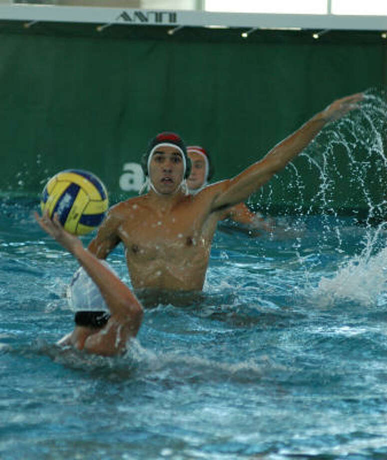 Strake Jesuit senior Santiago Lombo rises out of the water on defense against Alamo Heights during a 14-5 victory at the TISCA State Tournament in San Antonio last weekend. Photo: L. Scott Hainline, For The Chronicle