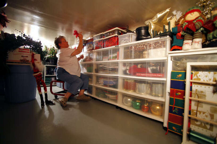 Ruth Patterson has the perfect place to store her mountains of holiday decorations. Her Lake  Livingston home sits 4 feet and 8 inches off the ground, and she has converted this crawl space into a decoration storage area, divided, of course, by holiday. Photo: Steve Ueckert, Chronicle