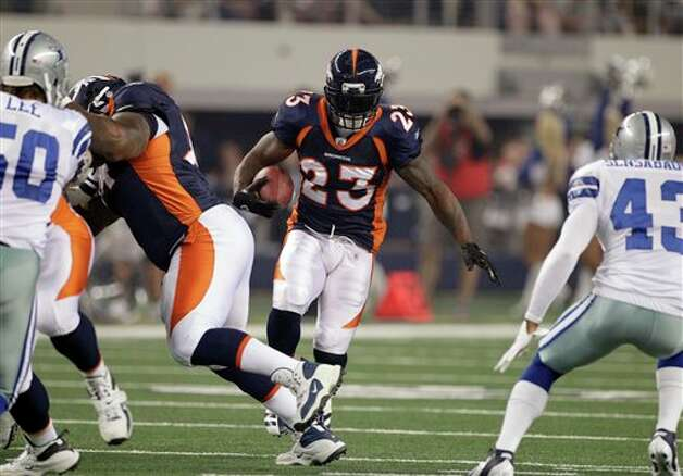Denver Broncos running back Willis McGahee takes the ball down the field against the Dallas Cowboys during the first quarter a preseason NFL football game Thursday, Aug. 11, 2011, in Arlington, Texas. (AP Photo/Tony Gutierrez) Photo: Tony Gutierrez, Associated Press / AP