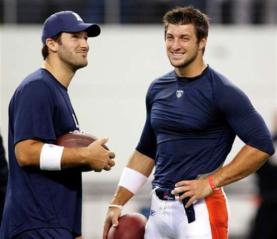 Dallas Cowboys quarterback Tony Romo, left, and Denver Broncos quarterback Tim Tebow talk before a preseason NFL football game Thursday, Aug. 11, 2011, in Arlington, Texas. (AP Photo/LM Otero) Photo: LM Otero, Associated Press / AP
