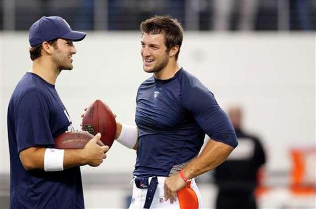 Dallas Cowboys quarterback Tony Romo, left, and Denver Broncos quarterback Tim Tebow talk before a football game Thursday, Aug. 11, 2011, in Arlington, Texas. (AP Photo/LM Otero) Photo: LM Otero, Associated Press / AP