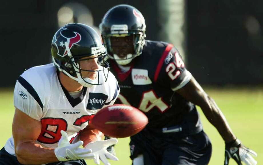 Houston Texans wide receiver Kevin Walter (83) makes a catch with cornerback Johnathan Joseph (24) defending during Texans training camp at the Methodist Training Center Thursday, Aug. 11, 2011, in Houston.  ( Brett Coomer / Houston Chronicle ) Photo: Brett Coomer, Staff / © 2010 Houston Chronicle