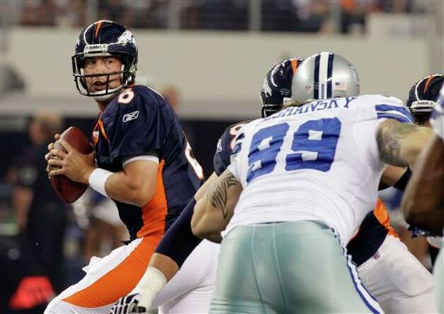 Denver Broncos quarterback Kyle Orton looks to pass as Dallas Cowboys defensive end Igor Olshansky defends. during the first quarter of a preseason NFL football game on Thursday, Aug. 11, 2011, in Arlington, Texas. (AP Photo/Tony Gutierrez) Photo: Tony Gutierrez, Associated Press / AP