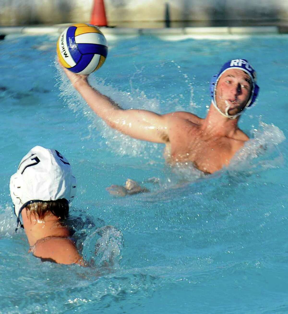 Rocky Point Club's Mark Nietzel competes during the Fairfield County Swim League Water Polo Championship game at Rock Point Club in Greenwich on Thursday, August 11, 2011.