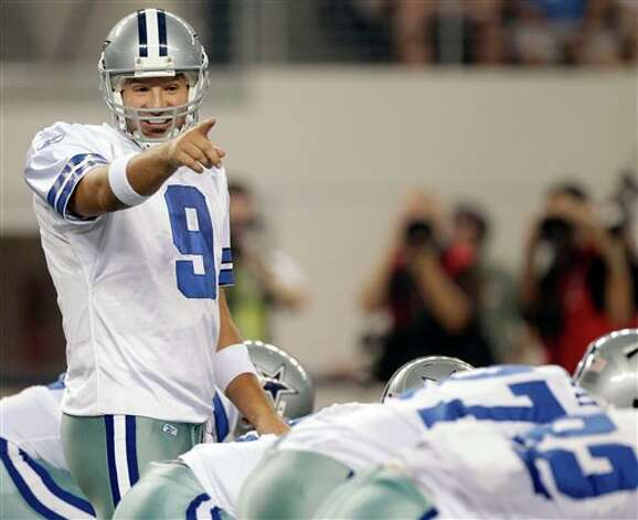 Dallas Cowboys quarterback Tony Romo (9) calls a play against the Denver Broncos during the first quarter of a preseason NFL football game Thursday, Aug. 11, 2011, in Arlington, Texas. (AP Photo/Tony Gutierrez) Photo: Tony Gutierrez, Associated Press / AP