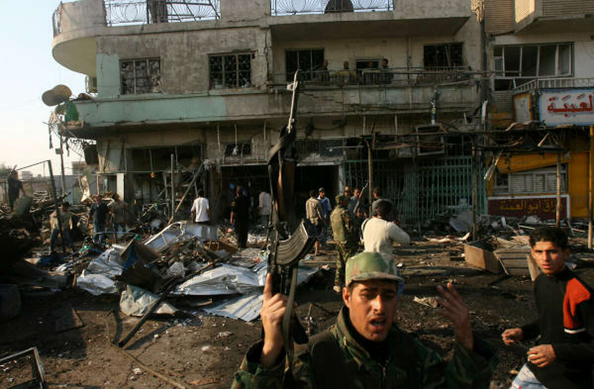A roadside bomb and two car bombs exploded in succession Sunday near a bus station in Baghdad, killing eight Iraqi civilians and wounding 43, according to police.