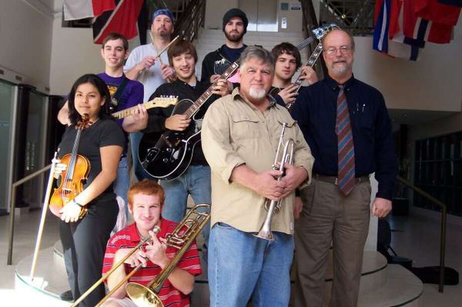 The Kingwood College Jazz Ensemble includes, top left, percussionist Matthew Wood, bass player Ryan Pennington; middle row, from left,  guitar players Zack Keen, Wes Verret, and Chase Demaster,; bottom row left, violinist Joadani Paredes, trombonist Austin Wolfe, trumpeter Eric Johnson and Director James Stubbs. Photo: Sonja Wait, For The Chronicle