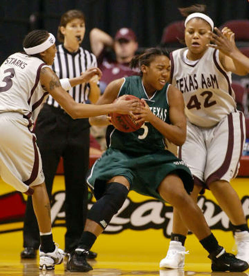 A&M's Takia Starks, left, and Adrian McGowen shut down Jo Hall of North Texas. Photo: Paul Zoeller, AP
