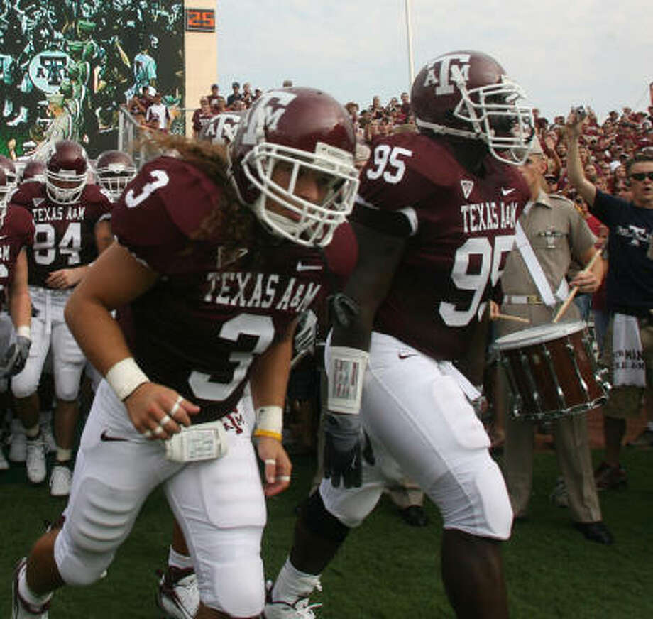 Ben Bitner (3) and the Aggies head onto the field before the game against The Citadel. Photo: Glen Johnson, Texas A&M