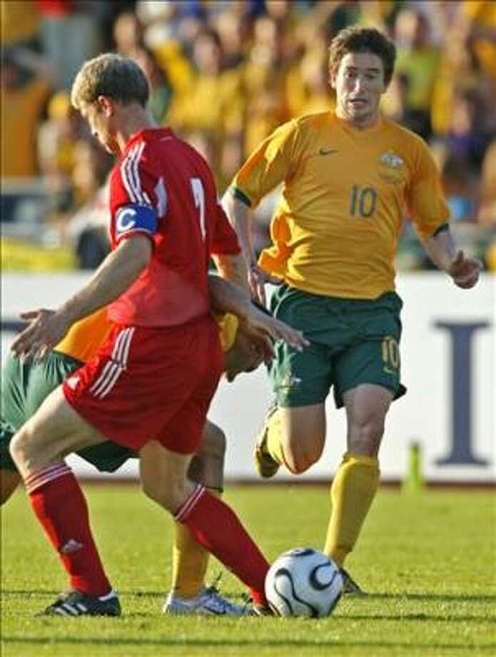 Australian forward Harry Kewell (R) manoeuvres the ball past Liechtenstein captain Daniel Hasler (L)  during the football friendly between Australia's Socceroos and Liechtenstein in Ulm, 07 June 2006, in the lead-up to the FIFA World Cup in Germany. The Socceroos defeated Liechtenstein 3-1. AFP PHOTO / Torsten BLACKWOOD Photo: TORSTEN BLACKWOOD, AFP