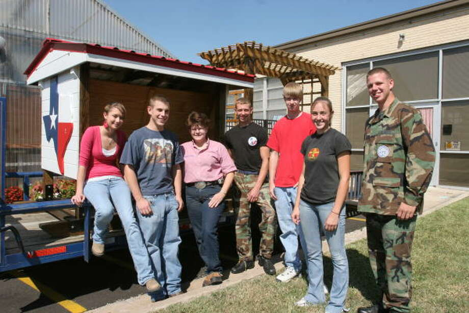 Dulles High School agriculture students built a cattle feeder and gazebo as part of their entry in the Fort Bend County Fair. From left are Kate Hardy, 18; Russell Brumley, 17; Bonnie Beard, agriculture science teacher; Jeremy Preite, 17;  Adam Korenek, 17; Cassie Poncik, 17; and Cody Osborne, 18. Photo: Suzanne Rehak, For The Chronicle