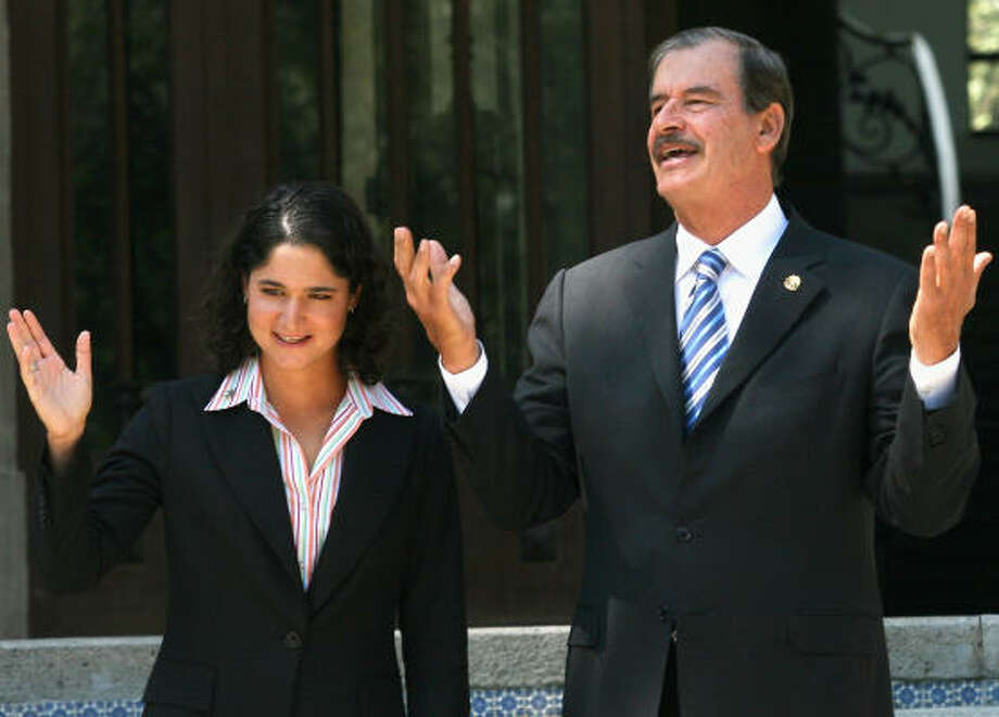 While his comments critical of the U.S. raised eyebrows here, many Mexicans agree with President Vicente Fox, shown Wednesday in Mexico City with national golf star Loreno Ochoa.