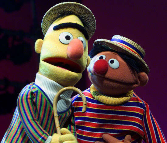 "FILE - In this Aug. 22, 2001 file photo, Muppets Bert, left, and Ernie, from the children's program ""Sesame Street,"" are shown in New York. An online petition calling for the nuptials of Muppet flat-mates Bert and Ernie has sparked controversy. Chicago resident Lair Scott, who posted the petition, is seeking matrimony for the ""Sesame Street"" chums as a way to make gay and lesbian kids who watch the show feel better about themselves, and to promote tolerance for people who are different. Sesame Workshop, which produces the long-running children's series, declared in a statement, ""They were created to teach preschoolers that people can be good friends with those who are very different from themselves."" (AP Photo/Beth A. Keiser, file) / AP2001"