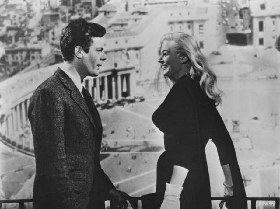 Marcello Mastroianni and Anita Ekberg star in Federico Fellini's 1960 film La Dolce Vita.