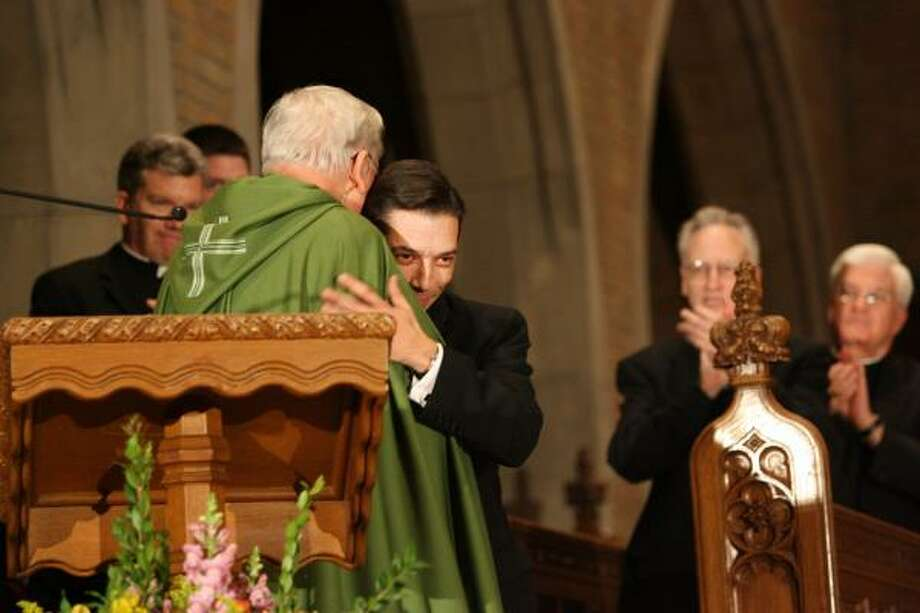Monsignor Daniel Flores, right, embraces Cardinal Adam Maida in Detroit after being named auxiliary bishop for the Archdiocese of Detroit at Sacred Heart Major Seminary Chapel. Photo: KIMBERLY P. MITCHELL, AP