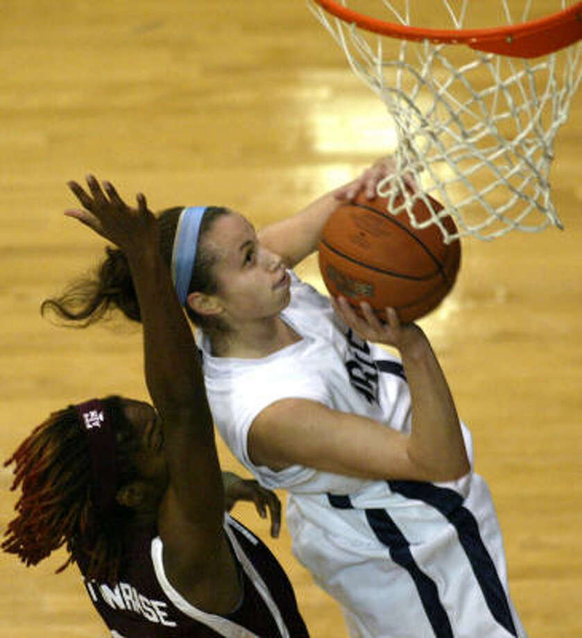 Rice's Kadie Riverin, right, beats Texas A&M's Morenike Atunrase during the first half. Photo: Jessica Kourkounis, For The Chronicle