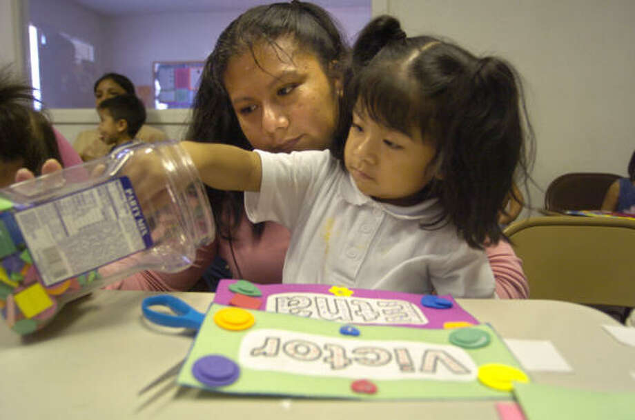 Juana Garcia and her daughter, Etna Avendano, 3, work on a project in an English class in south Houston. Garcia came to the U.S. six years ago from Mexico and recently began English classes. Photo: Johnny Hanson, For The Chronicle