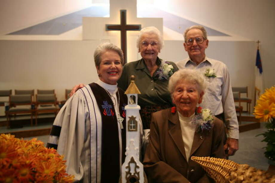 New Hope Presbyterian Church at 1350 North Mason Road in Katy recently celebrated the church's 100th birthday.  The Rev. Belinda Windham, left, honored the three oldest members: Anna Baker, 90, center; Altha Dimon, 96; and Glen Fry, 87. Photo: Suzanne Rehak, For The Chronicle