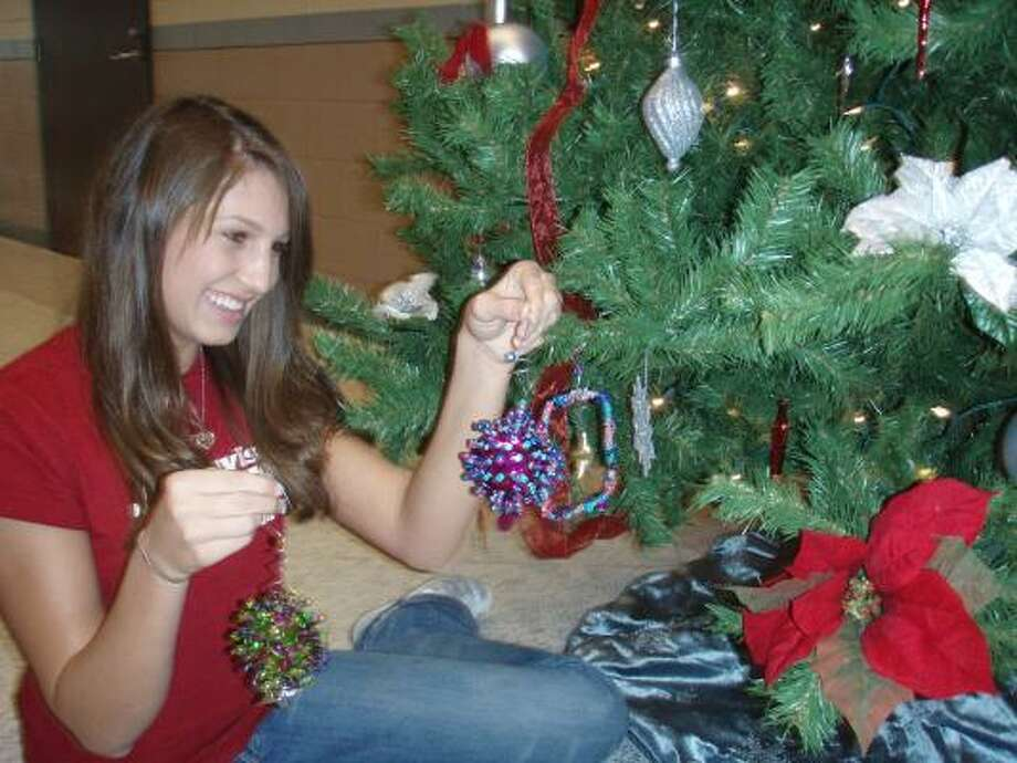 Reagan Davis, 16, made a set of six ornaments as part of a project by math students at William B. Travis High School in Richmond. Photo: Handout