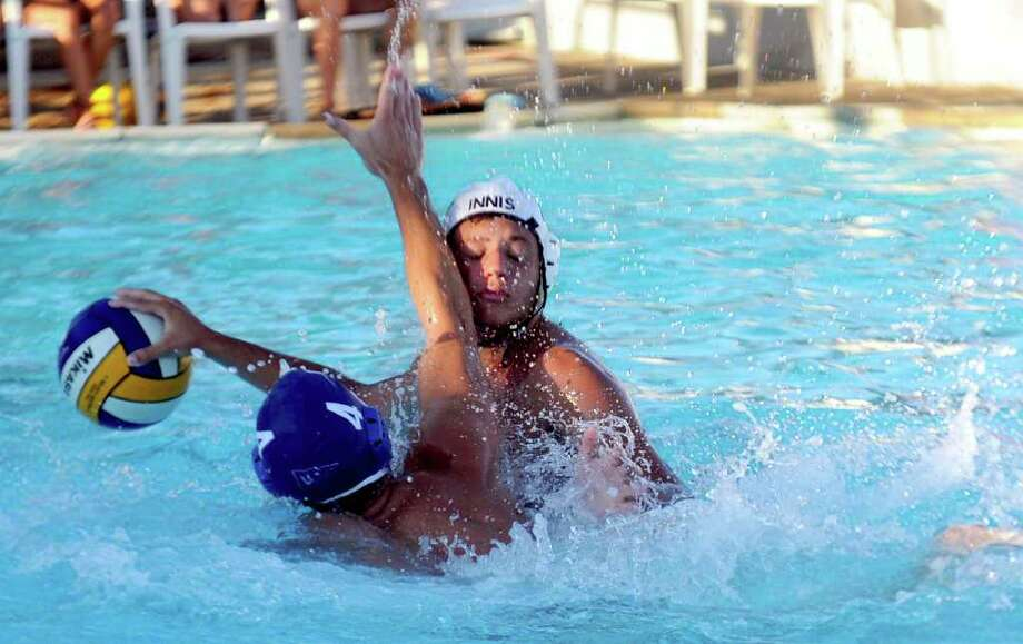 Innis Arden competes against Rocky Point Club during the Fairfield County Swim League Water Polo Championship game at Rock Point Club in Greenwich on Thursday, August 11, 2011. Photo: Lindsay Niegelberg, Niegelberg / Stamford Advocate