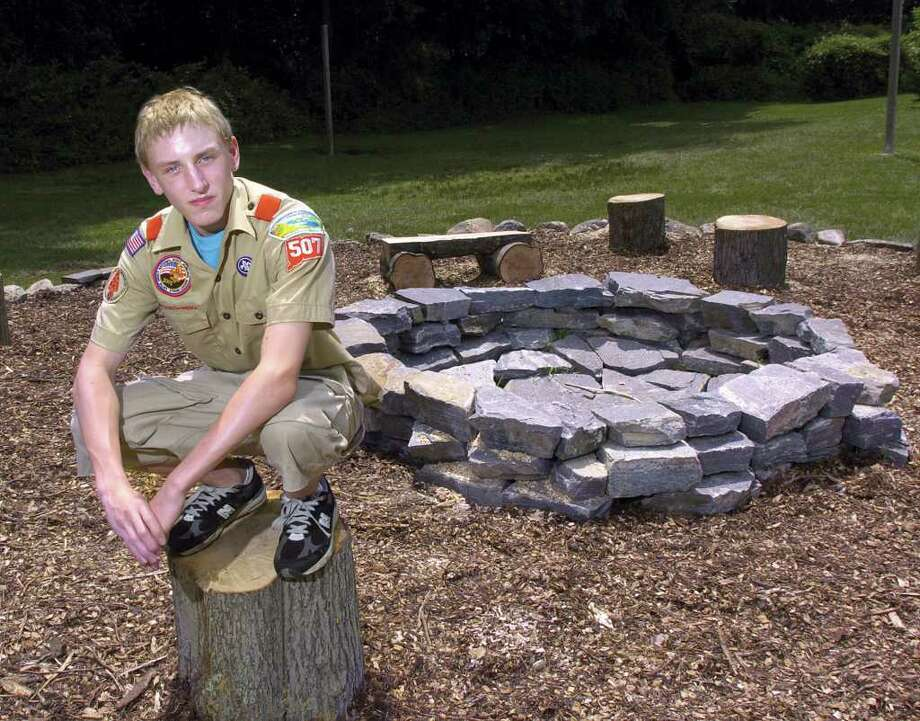 In this 2004 file photo, Michael DeFruscio, 16, of Greenwich, Troop 507, poses by the outdoor classroom he created at Camp Simmons in Greenwich for his Eagle Scout designation. Defruscio, 23, was killed in a one-car crash on Interstate 95 in Greenwich early in the morning of Thursday, Aug. 11, 2011, state police said. Photo: File Photo / Greenwich Time File Photo