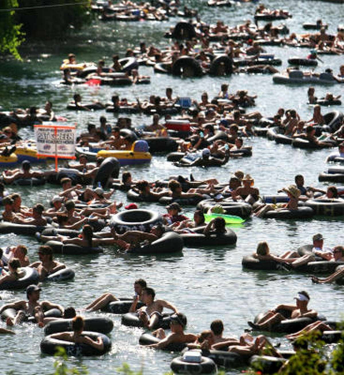 Tubing picked up on the Comal, above, after a drought led to a drop in visitors to the larger Guadalupe River.