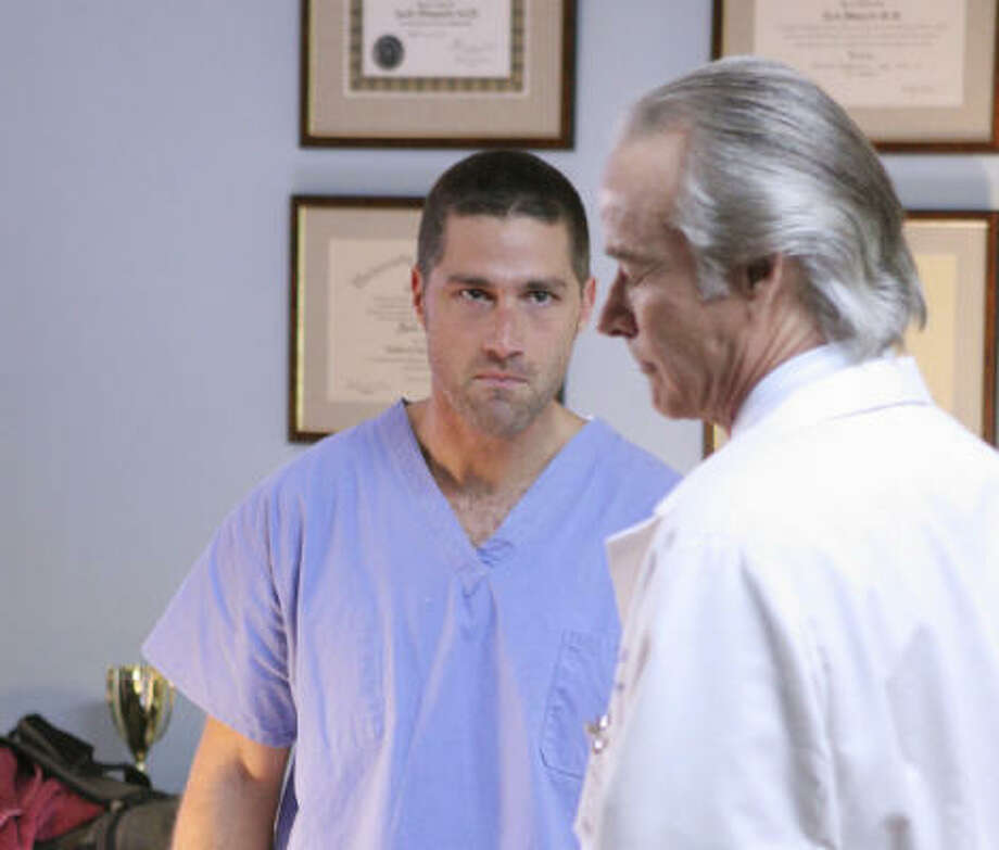 In a flashback, Jack (Matthew Fox, left) argues with his father (John Terry) on ABC's Lost. Photo: MARIO PEREZ, ABC