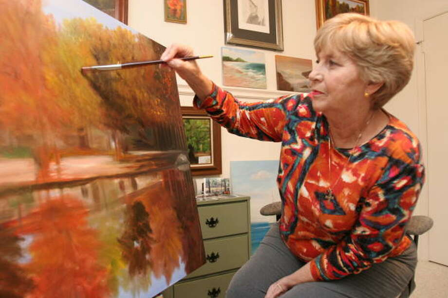 Betty Pimm, 67, a retired nurse from Sugar Land, puts the finishing touches on a painting that will be hung in the waiting room of The Surgery Center of The Woodlands.  Three other paintings of hers will also be displayed there. Photo: Suzanne Rehak, For The Chronicle