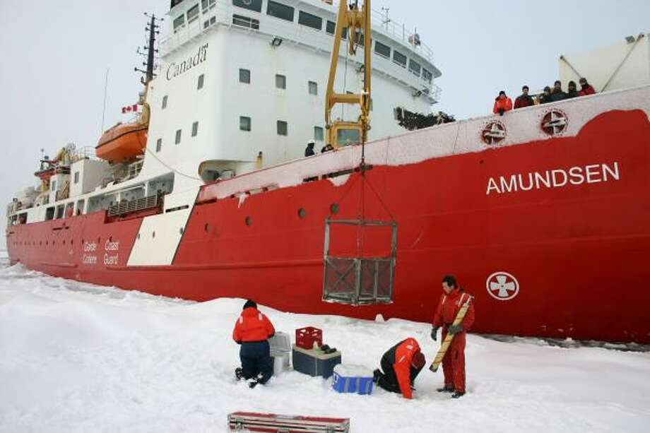 Scientists from the Canadian Coast Guard icebreaker Amundsen take samples from ice along the Northwest Passage, well after the Arctic usually is iced over for the winter. They fear new opportunities for shipping companies will bring risks of accidents and oil spills. Photo: Doug Struck, Washington Post