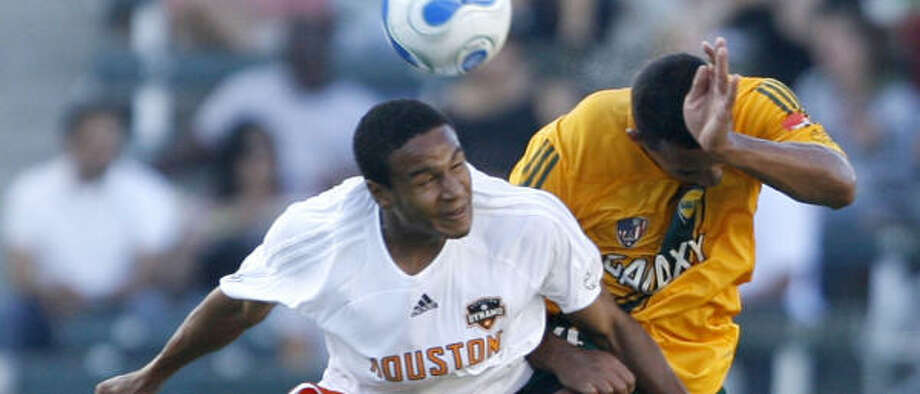 Houston's Ricardo Clark (left) is only the second player to be suspended for the MLS Cup. Photo: MATT SAYLES, AP