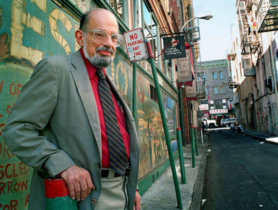 In 1994, poet Allen Ginsberg posed for this photo in San Francisco's Jack Kerouac Alley next to City Lights bookstore, which this year held several events marking the 50th anniversary of Howl. Photo: ELIZABETH MANGELSDORF, Associated Press